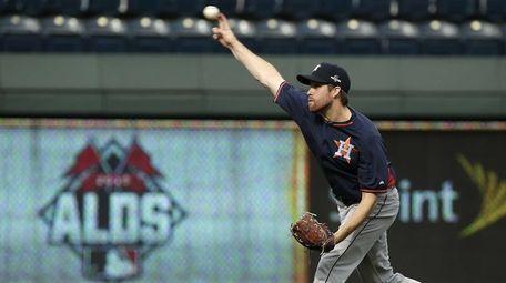 Houston Astros starting pitcher Collin McHugh throws during