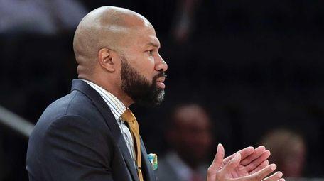 New York Knicks head coach Derek Fisher coaches