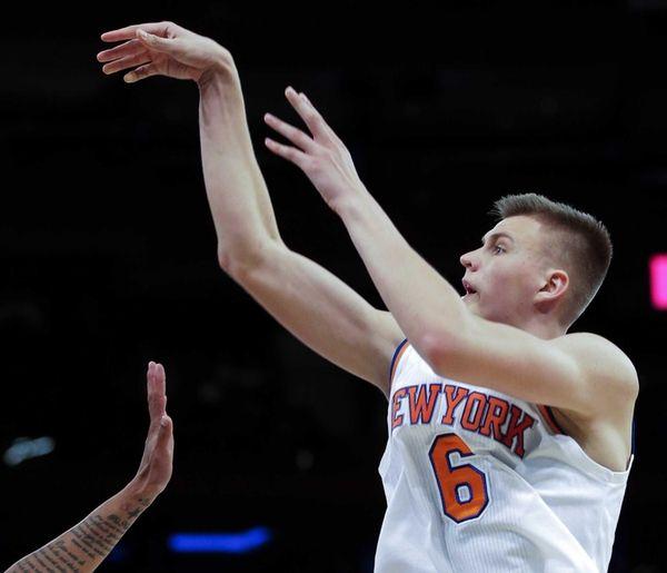 New York Knicks forward Kristaps Porzingis gets off