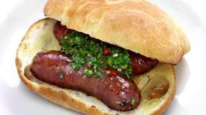 Choripan, an Argentinian sandwich of grilled chorizo topped