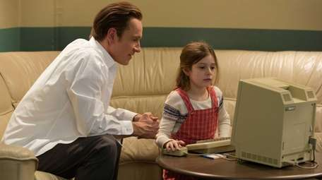 Michael Fassbender, left, and Makenzie Moss appear in