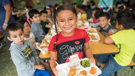 Kindergartener Serenity Rodriguez, 5, with her lunch at