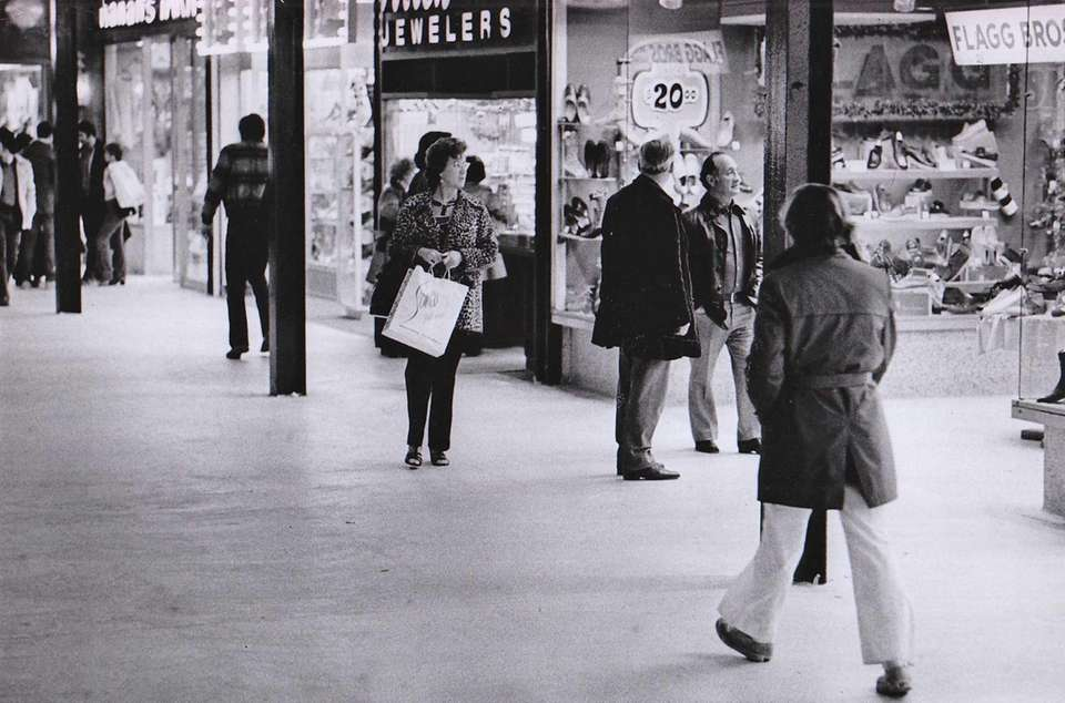 Shoppers at Roosevelt Field Mall check out the