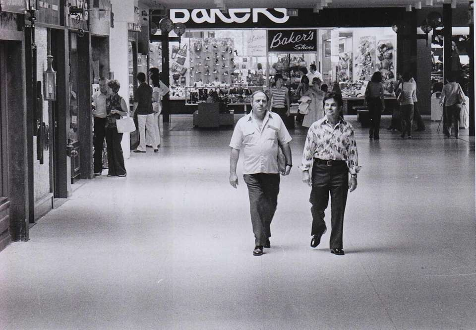 Shoppers meander about Roosevelt Field Mall on a