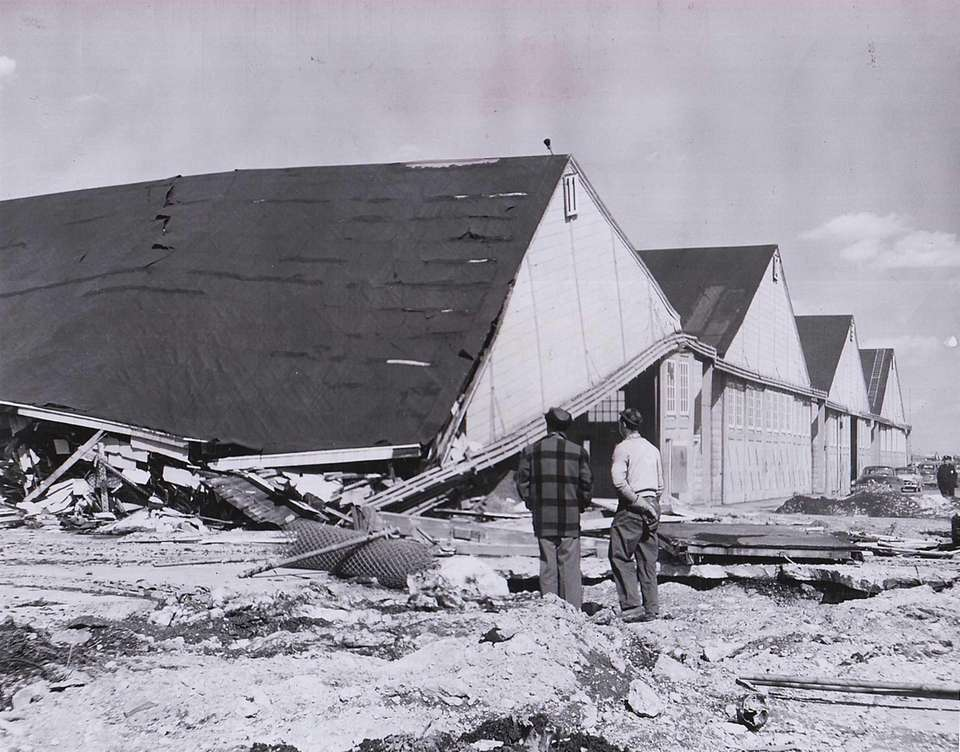 Two men observe demolition of hangars at Roosevelt