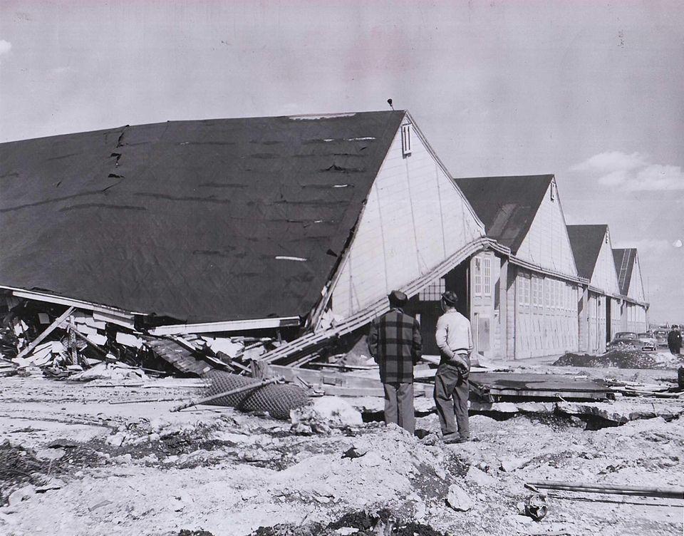 Two men observe demolition of hangars at Roosevelt