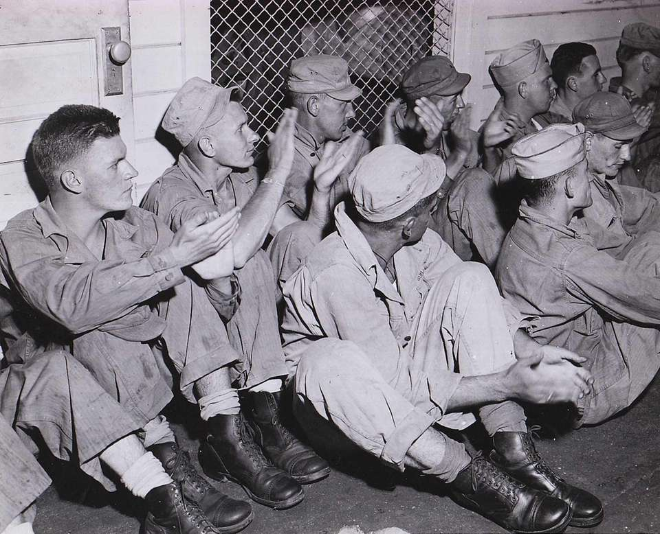 A group of Air Force mechanic trainees applaud