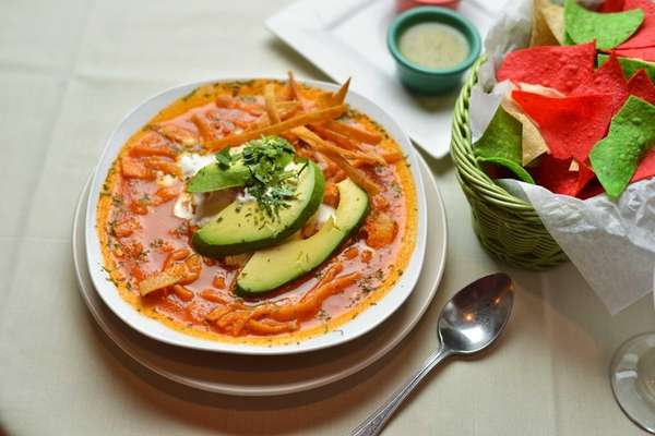 A bowl of hearty tortilla soup made with