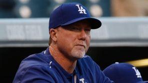 Los Angeles Dodgers batting coach Mark McGwire (25)