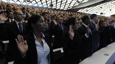 A new class of NYPD recruits are sworn