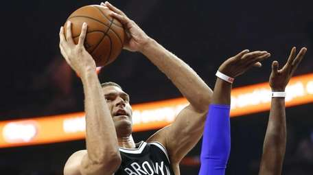 Brooklyn Nets center Brook Lopez (11) shoots against