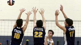 Eastport-South Manor's Tom Ogeka (4) with the spike