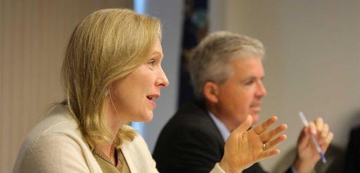 Sen. Kirsten Gillibrand speaks beside Suffolk County Executive
