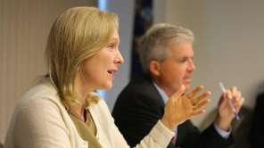 Sen. Kirsten Gillibrand speaks beside Suffolk County Executive