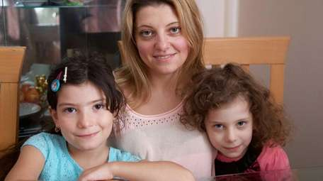 Yana Krasnov, with daughters Alice, 7, left, and