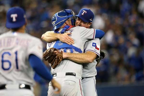 Ross Ohlendorf of the Texas Rangers celebrates with