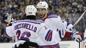 New York Rangers' Jarret Stoll, right, congratulates Mats