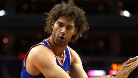 Robin Lopez of the New York Knicks gestures