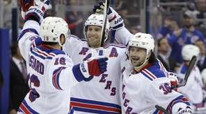 New York Rangers' Mats Zuccarello, right, celebrates his