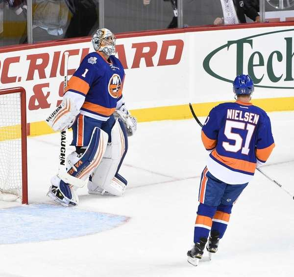 New York Islanders goalie Thomas Greiss reacts after