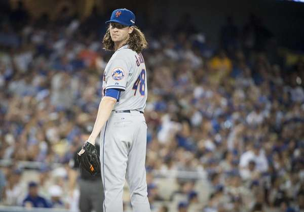 New York Mets pitcher Jacob deGrom looks over