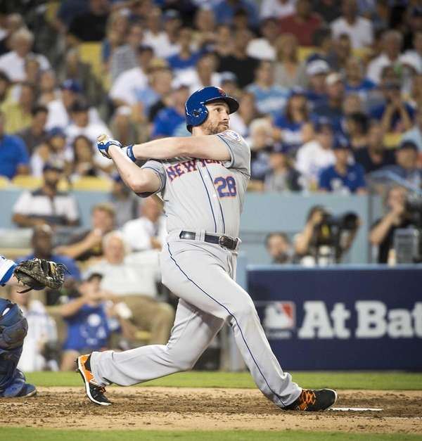 New York Mets' Daniel Murphy hits a one