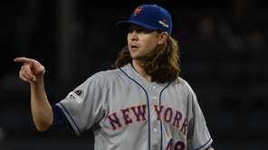 New York Mets pitcher Jacob deGrom reacts in
