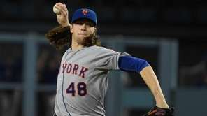 New York Mets pitcher Jacob deGrom throws during