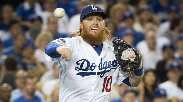 Dodgers 3rd baseman Justin Turner throwing to first