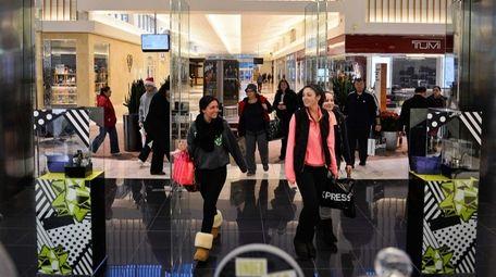 People walk through the doors of Bloomingdale's at