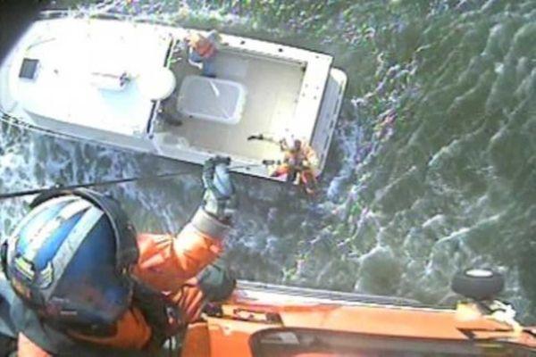 Coast Guard rescuers hoist Dan Zecchini, 45, of