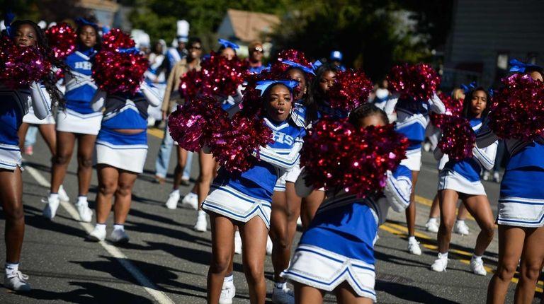 Hempstead High School cheerleaders cheer as students participate