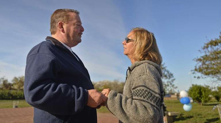 Dix Hills resident John Brower, 59, comforts Janet