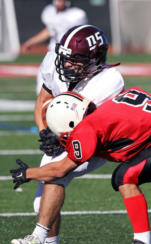North Shore's John Magliocco gets good yards during