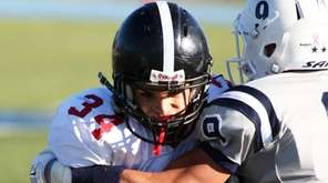 Syosset's Christian DeLuca, no.34, tries to get away