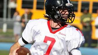 Syosset quarterback William Hogan looks for some running