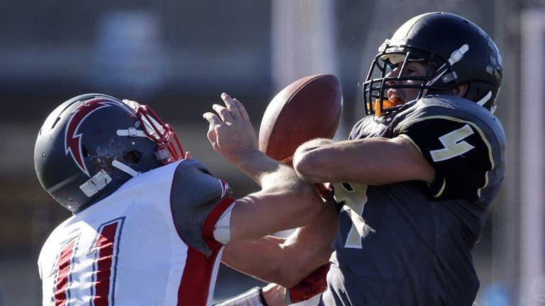 Connetquot defensive back Jack Spataro (11) strips the