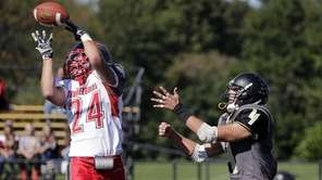 Connetquot defensive back Jake Piccininni (24)steps in front