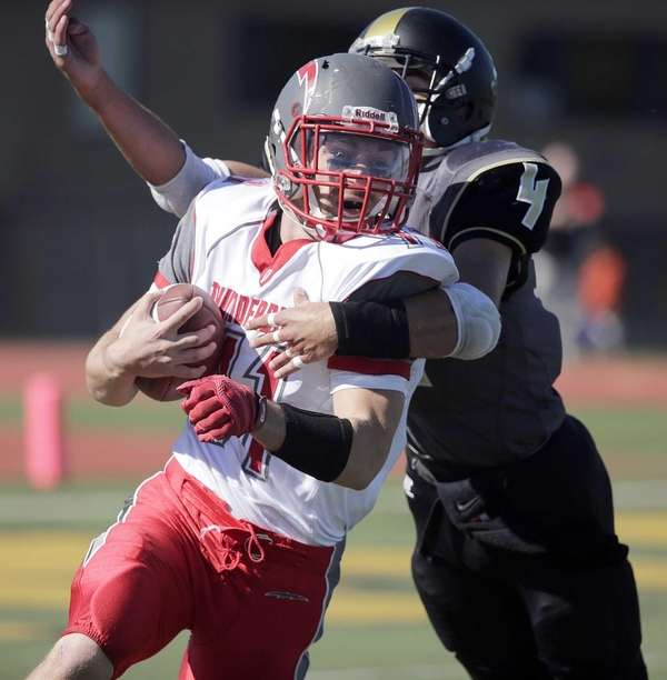 Connetquot running back Jack Spataro (11) is caught
