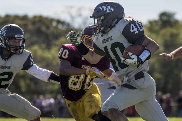 Westhampton's Dylan Laube, number 40, plows through a