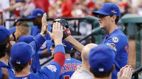 Chicago Cubs starting pitcher Kyle Hendricks is greeted