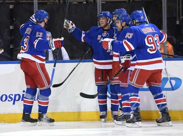 New York Rangers center Oscar Lindberg, center, and