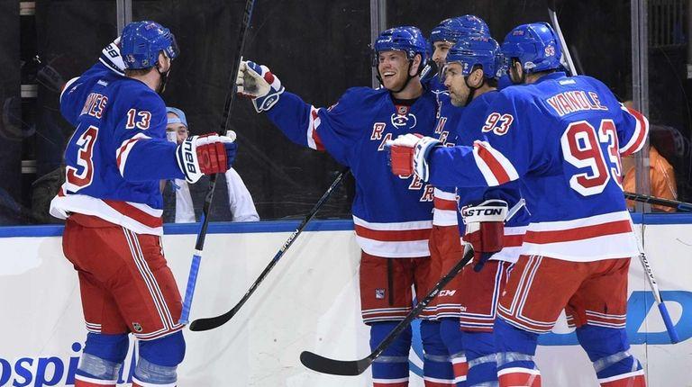 New York Rangers center Oscar Lindberg, center, and
