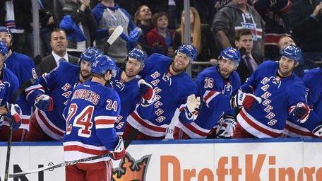 New York Rangers center Oscar Lindberg is congratulated