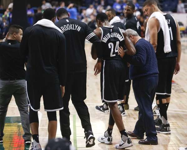 Brooklyn Nets forward Rondae Hollis-Jefferson (24) is helped