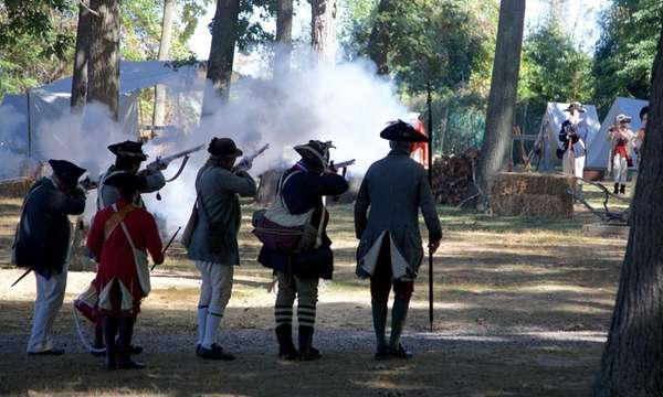 Revolutionary war reenactors perform at Callahan's Beach in