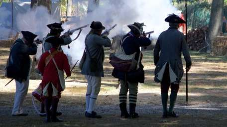 Revolutionary war reenactors perform at Callahan's Beach in