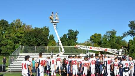 Dix Hills firefighters rescue two Smithtown East football