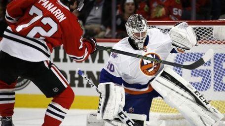 New York Islanders goalie Jean-Francois Berube (30) blocks