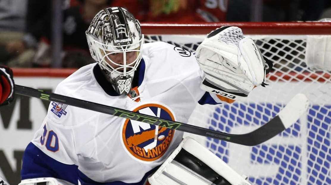 New York Islanders goalie Jean-Francois Berube (30) blocks